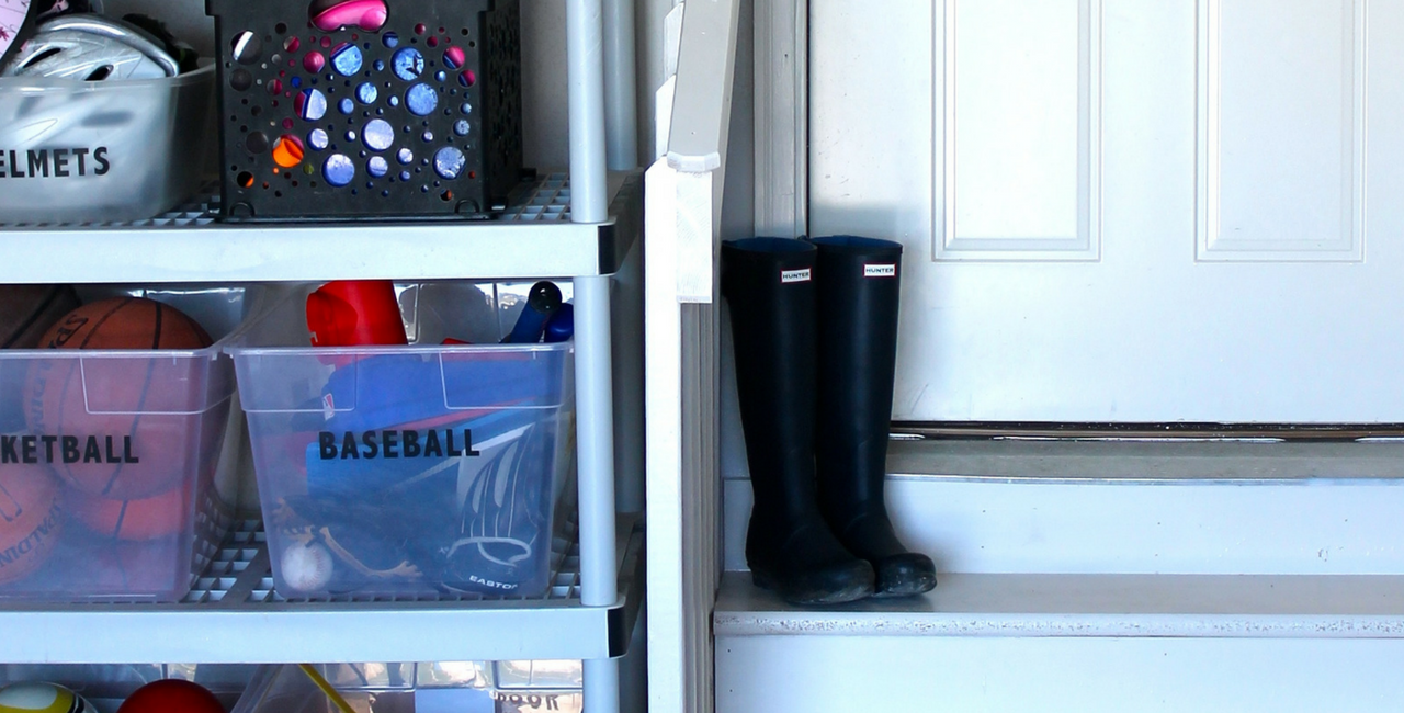 garage toy storage with boots by door