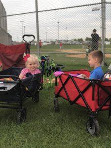 little siblings at baseball