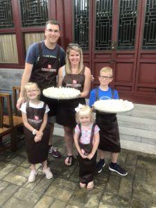 family holding Chinese dumplings