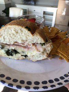Baked turkey artichoke dip sandwich
