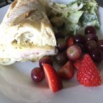 turkey pesto baked sandwich with fruit and salad