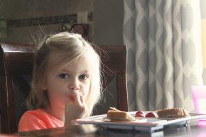 little girl eating dinner