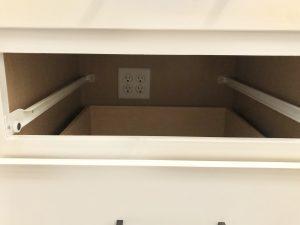 Plug for charging station drawer