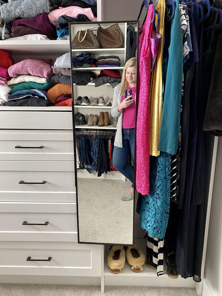 Stowable closet mirror
